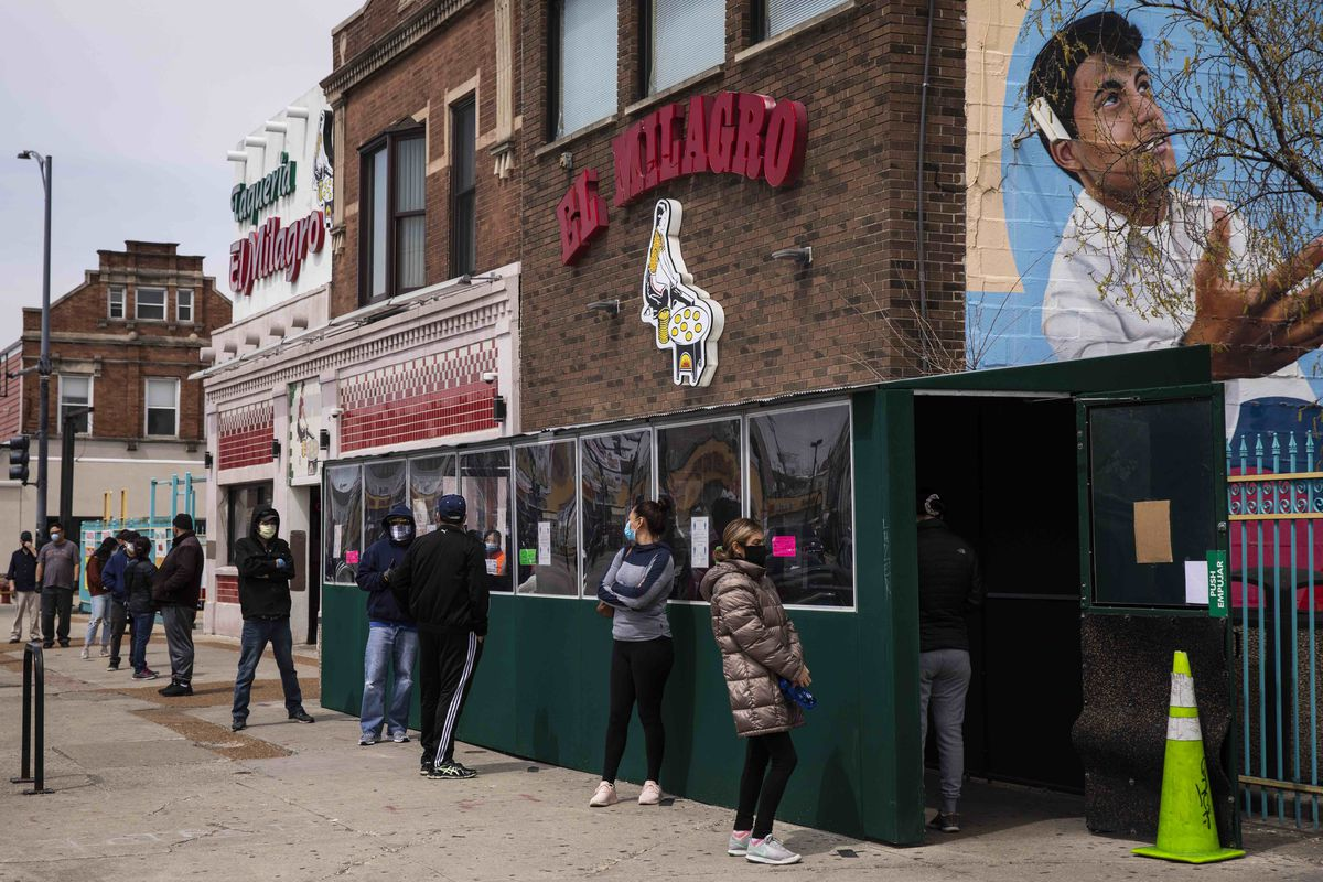 People line up outside Tortilleria El Milagro, 3048 W. 26th St. in Little Village, to buy tortillas after it was rumored that one of the company's factories would be closing for at least two weeks amid fears of the coronavirus pandemic, Monday, April 27, 2020.