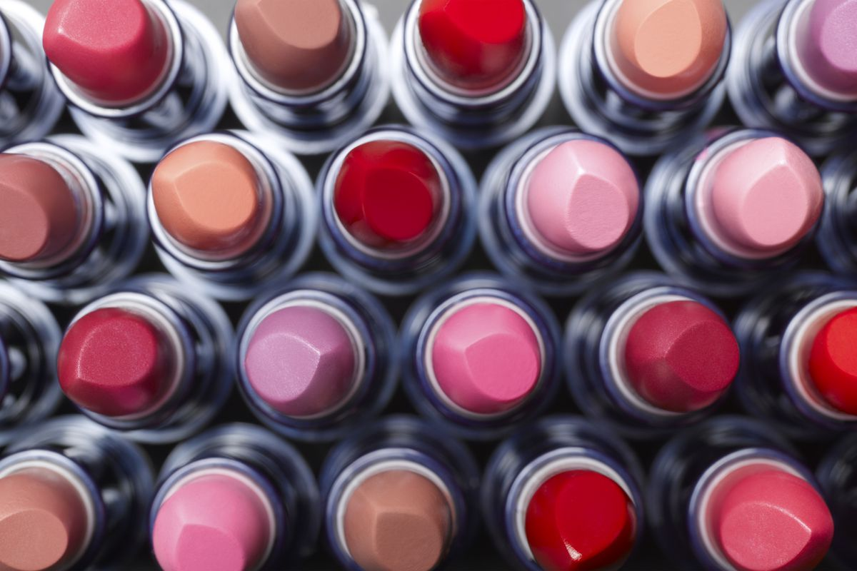 An array of lipsticks without their lids.