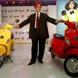 Chairman and Managing Director of Piaggio Vehicles Limited India Ravi Chopra poses with Vespa scooters during their launch in Mumbai, India, Thursday, April 26, 2012. The Italian company hopes to carve out a market for luxury scooters in one of the most cost-conscious markets in the world. The Vespa LX will cost around 66,661 rupees ($1,282) in India, a 40 percent premium to most scooters, but still the lowest sticker price in the world.
