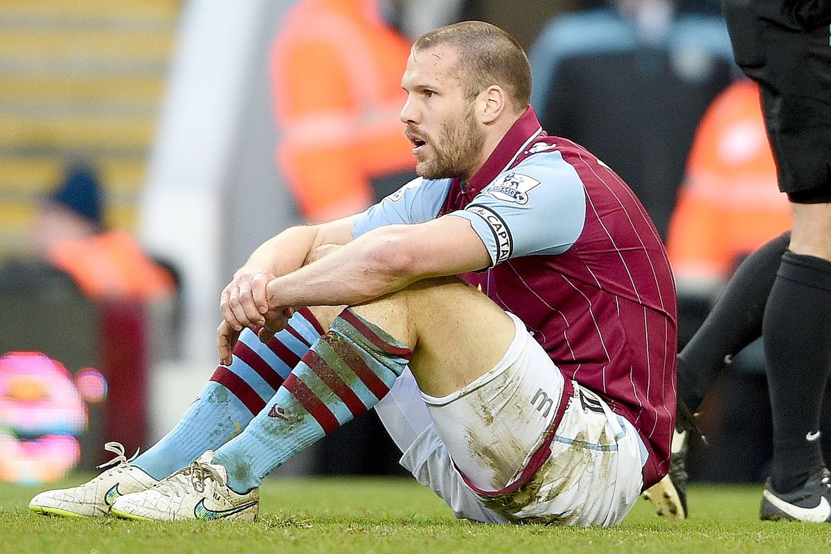 Ron Vlaar sits on the ground after conceding a penalty against Stoke City.