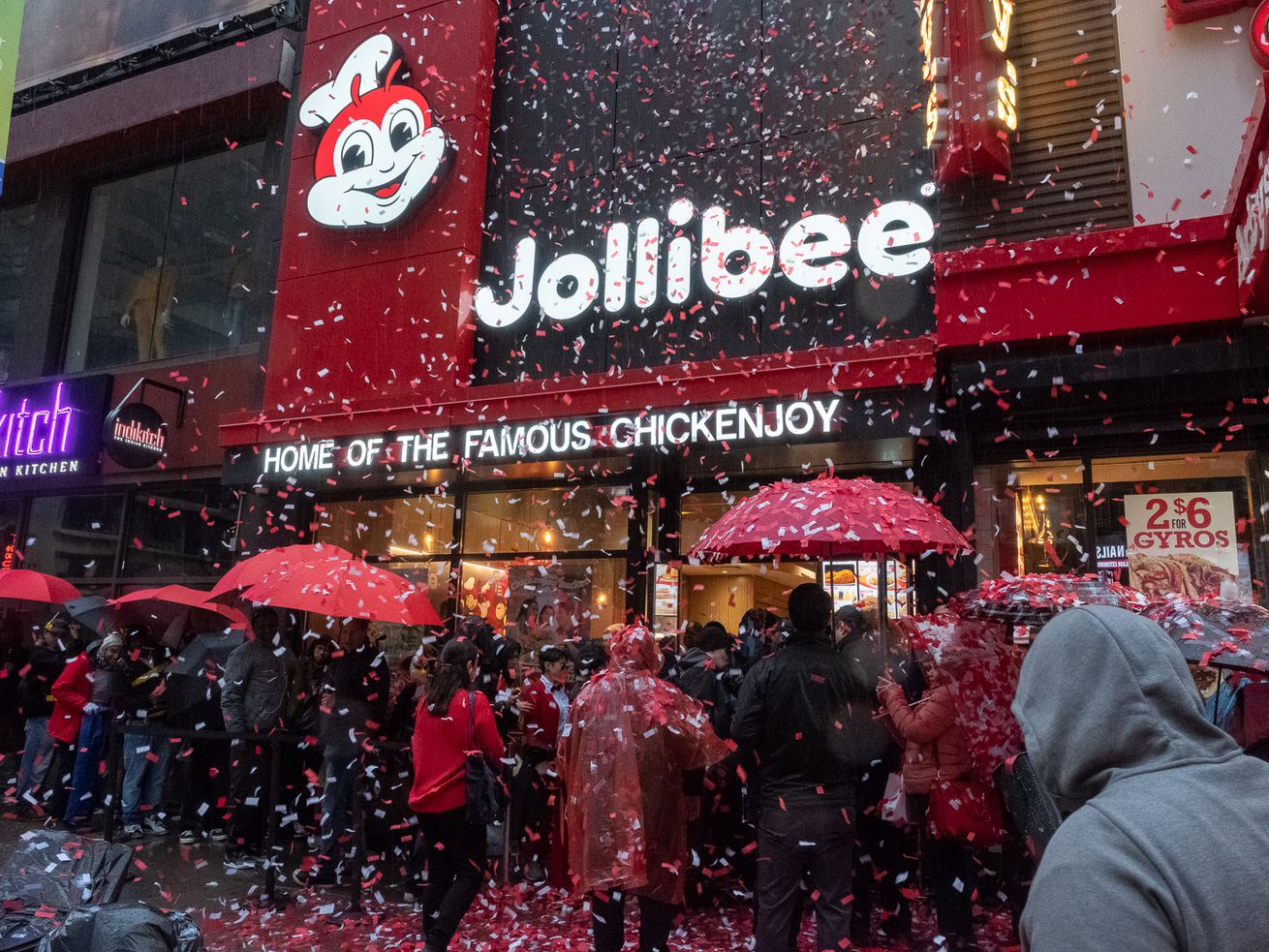 The weekend's nor'easter shower is momentarily replaced by a shower of confetti at the opening of Jollibee on 609 Eighth Ave. in Midtown Manhattan.