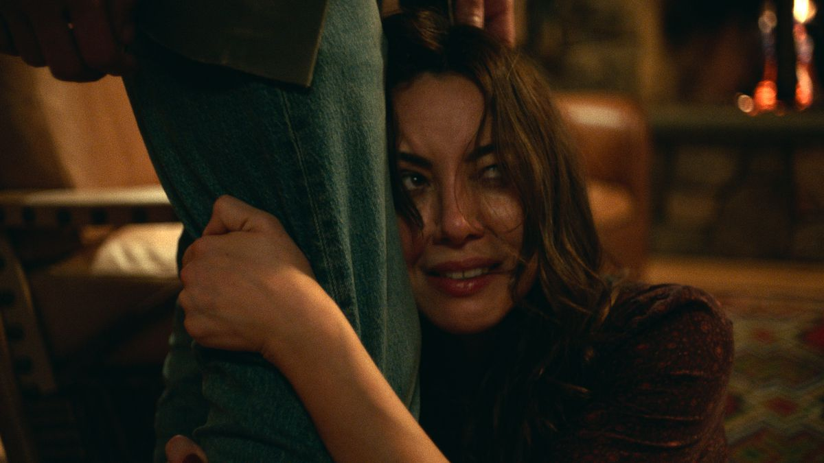aubrey plaza clinging to a curtain in black bear