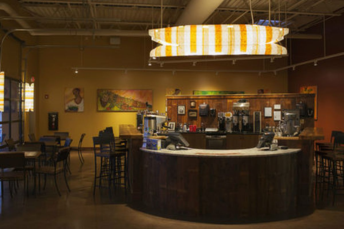 """<a href=""""http://maine.eater.com/archives/2014/02/28/take-a-peek-inside-coffee-by-designs-bold-new-coffeehouse-and-roastery.php"""">Coffee by Design</a>."""