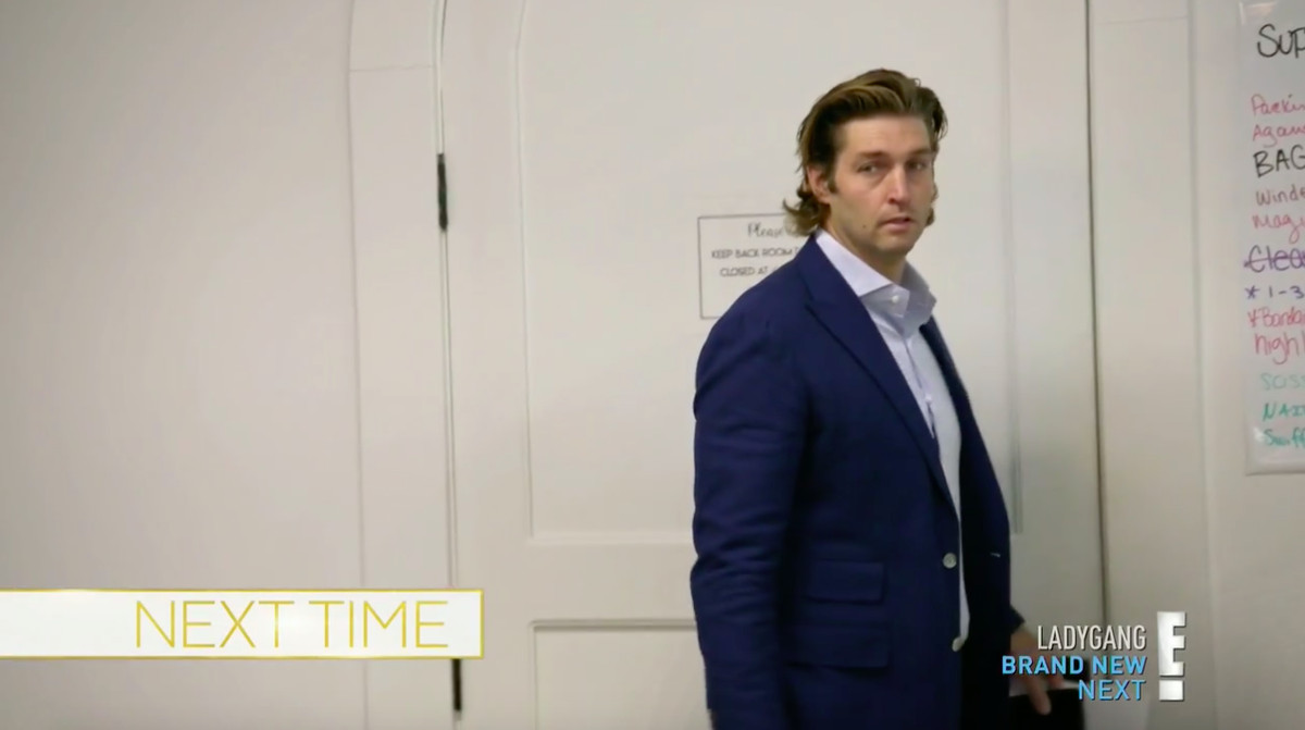 Jay Cutler with his hair slicked back, wearing a blue blazer