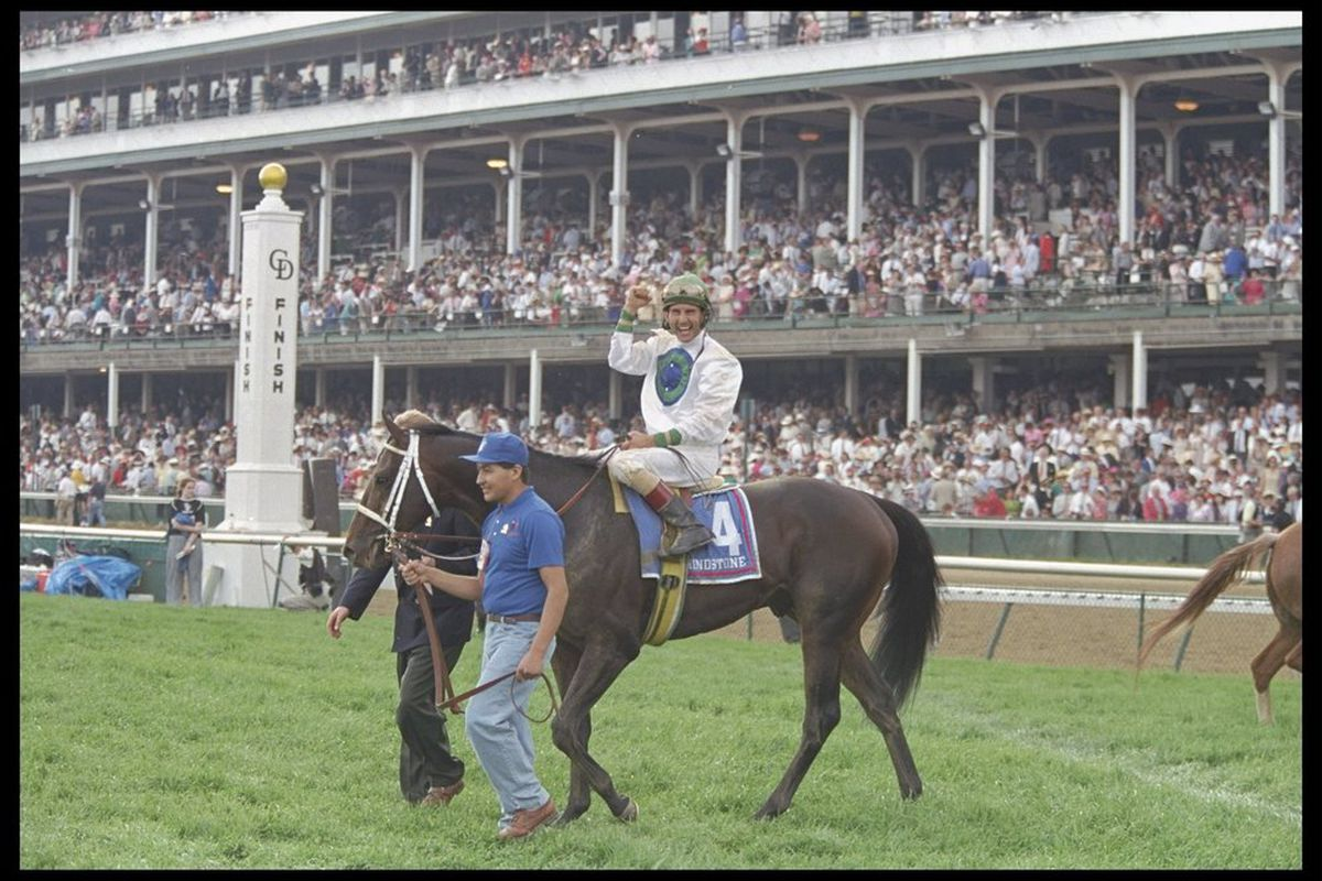 May 1996: Jerry Bailey on Grindstone waves to the crowds as a handler leads the horse off the track after winning the Kentucky Derby at Churchill Downs in Louisville, Kentucky. Mandatory Credit: Simon Bruty /Allsport Date created:
