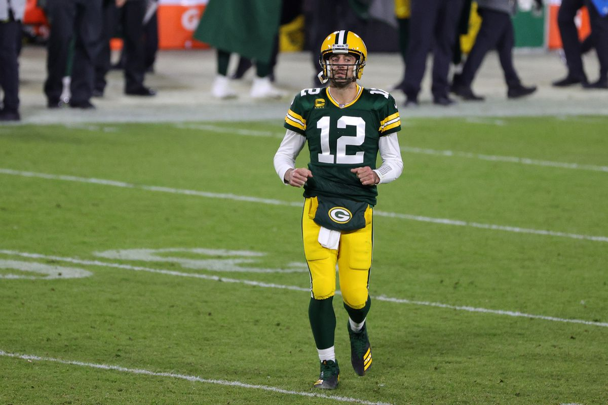 Aaron Rodgers #12 of the Green Bay Packers walks to the huddle during a game against the Philadelphia Eagles at Lambeau Field on December 06, 2020 in Green Bay, Wisconsin. The Packers defeated the Eagles 30-16.
