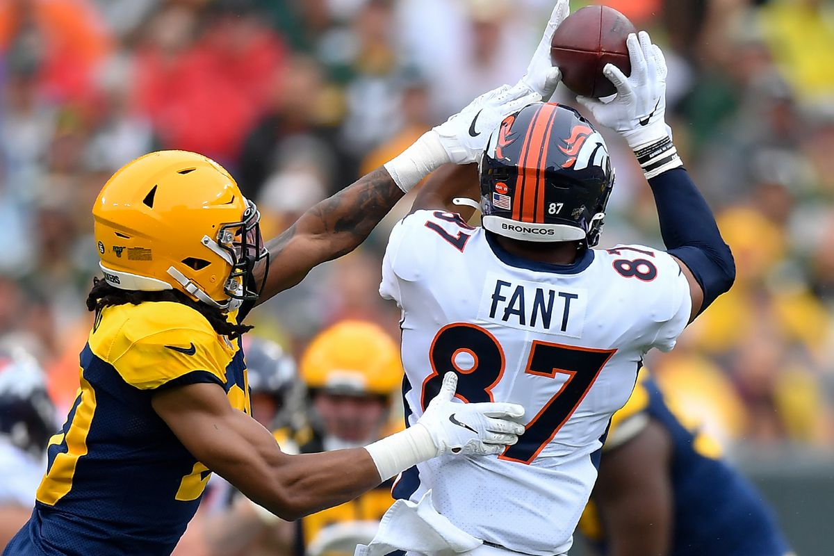 Noah Fant #87 of the Denver Broncos catches a pass in the second quarter against Kevin King #20 of the Green Bay Packers at Lambeau Field on September 22, 2019 in Green Bay, Wisconsin.