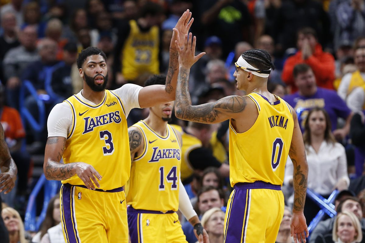 Los Angeles Lakers forward Anthony Davis and forward Kyle Kuzma high-five following Davis basket against the Oklahoma City Thunder during the second half at Chesapeake Energy Arena. Los Angeles won 130-127.