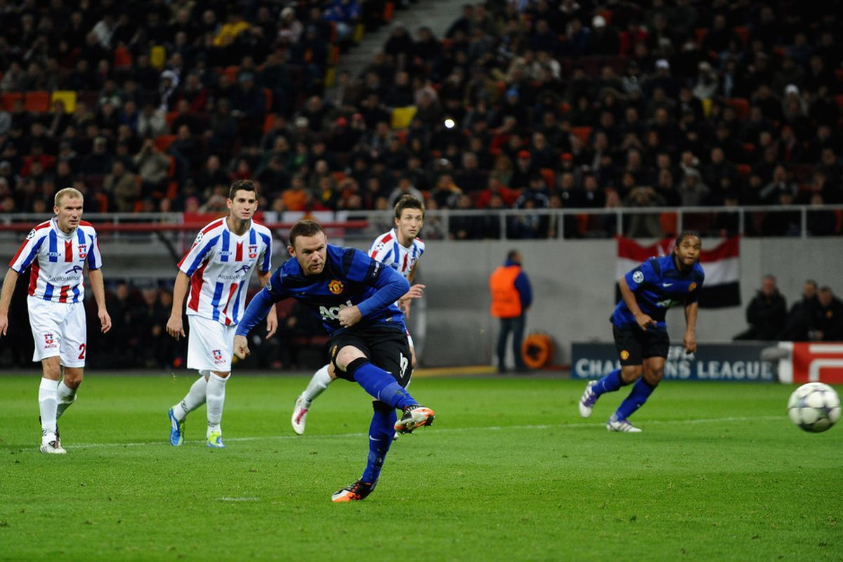 Wayne Rooney scored twice from the penalty spot in Manchester United's 2-0 away victory over Otelul Galati.