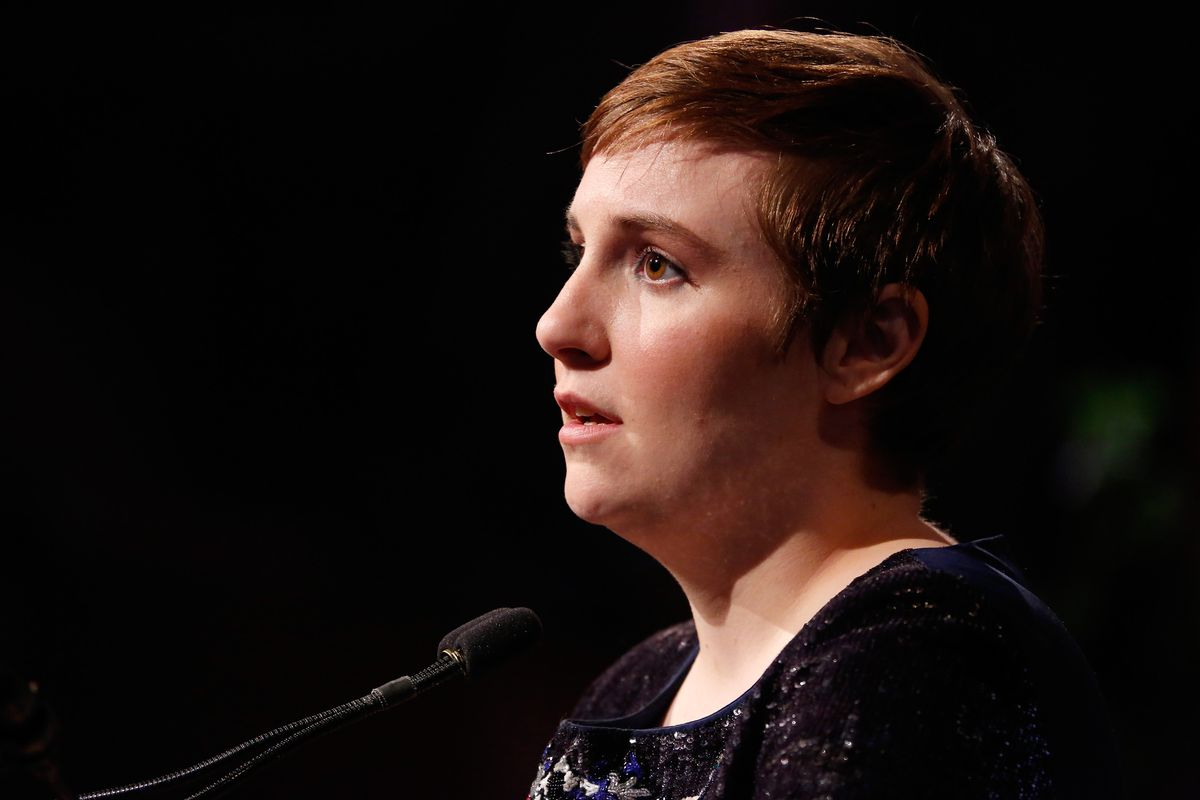 Lena Dunham speaks on stage at Variety's Power of Women awards.