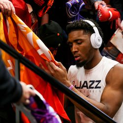 Utah Jazz guard Donovan Mitchell (45) signs a jersey before the game against the Portland Trailblazers at Vivint Smart Home Arena in Salt Lake City on Friday, Feb. 7, 2020.