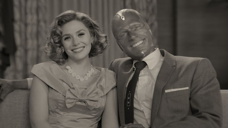 Wanda and Vision, in black and white, smile for the camera.