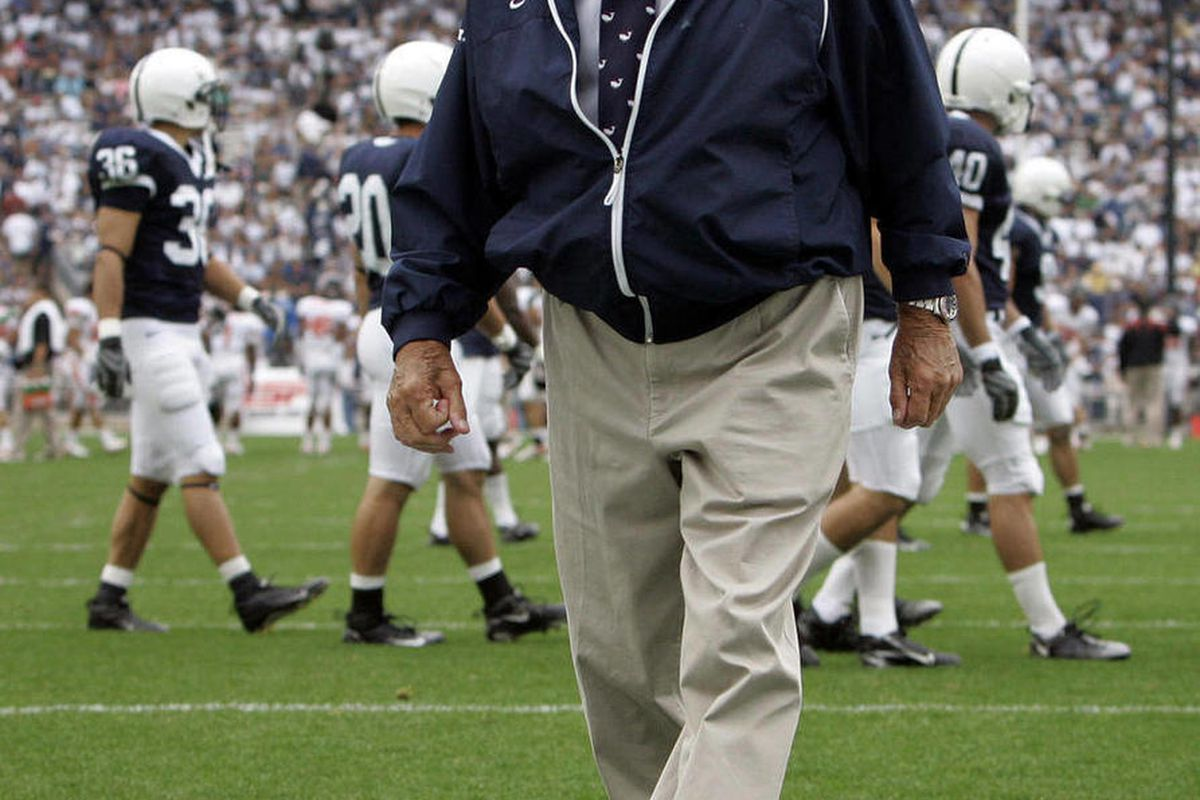 FILE - In this Sept. 6, 2008, file photo, Penn State coach Joe Paterno walks the field during warmups before their NCAA college football game against Oregon State in State College, Pa. Penn State said it provided more than $5.5 million in payments and ben