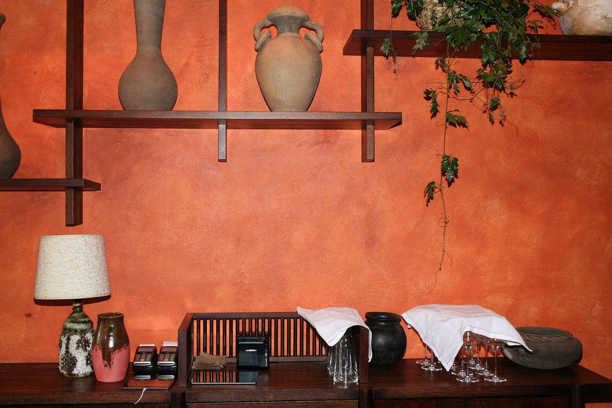 Kol's interior uses earthy tones, dark woods, and soft furnishings, Santiago Lastra's new Mexican restaurant in Marylebone, central London