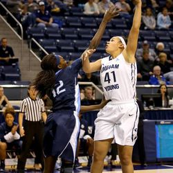 """Morgan Bailey(41) sinks a left handed hook shot against San Diego at the Marriott Center in Provo January 24, 2015.   <img src=""""http://beacon.deseretconnect.com/beacon.gif?cid=245925&pid=7"""" />"""