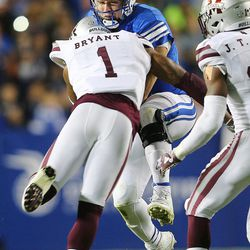 Brigham Young Cougars quarterback Taysom Hill (7) gets hit hard by Mississippi State Bulldogs defensive back Brandon Bryant (1) just after delivering what turned out to be the game-winning score as BYU defeats Mississippi State 28-21 in overtime in Provo at LaVell Edwards Stadium on Friday, Oct. 14, 2016.