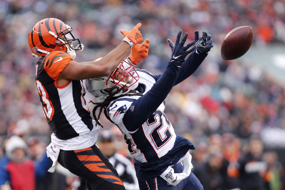 New England Patriots cornerback Stephon Gilmore breaks up a pass intended fro Cincinnati Bengals wide receiver Tyler Boyd during the second half at Paul Brown Stadium.