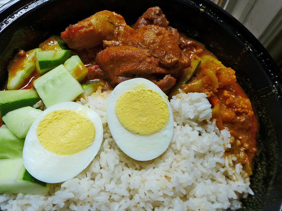 Rice, boiled eggs, and chicken curry.