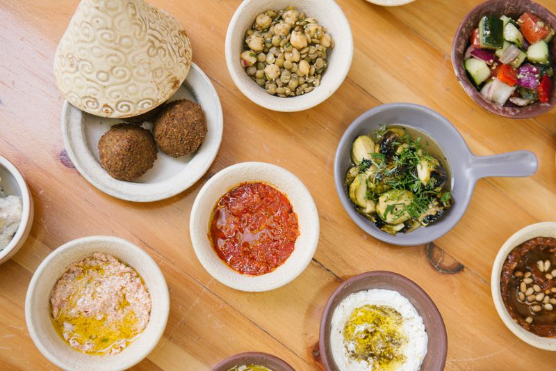 a number of small dishes with various Israeli foods.