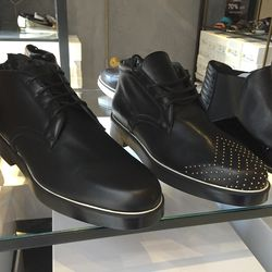 Men's ankle boots in black ($255) and gold studs ($309)