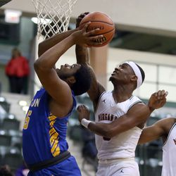 Simeon's Jeremiah Stamps (15) has his shot blocked by Morgan Park's Kyel Grover (0) in their CPS semi final game at Chicago State University, Friday, February 15, 2019. | Kevin Tanaka/For the Sun Times