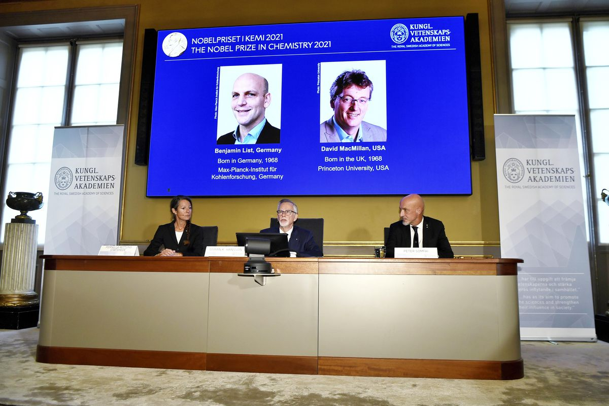 Goran K Hansson, Permanent Secretary of the Royal Swedish Academy of Sciences, centre, announces the winners of the 2021 Nobel Prize in Chemistry, in Stockholm, Sweden, Wednesday, Oct. 6, 2021.