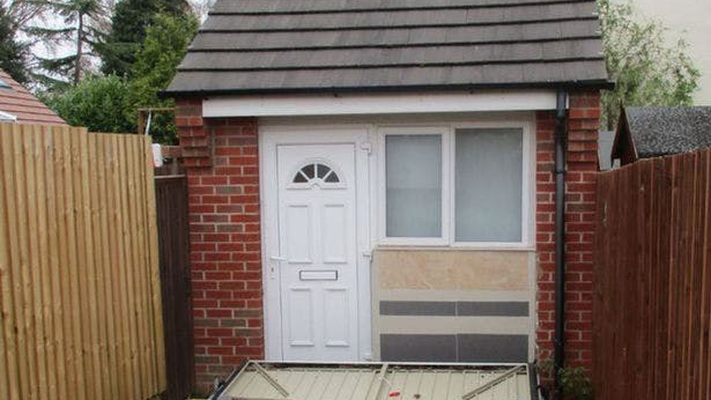 U.K. couple used a fake garage door to hide illegal tiny house