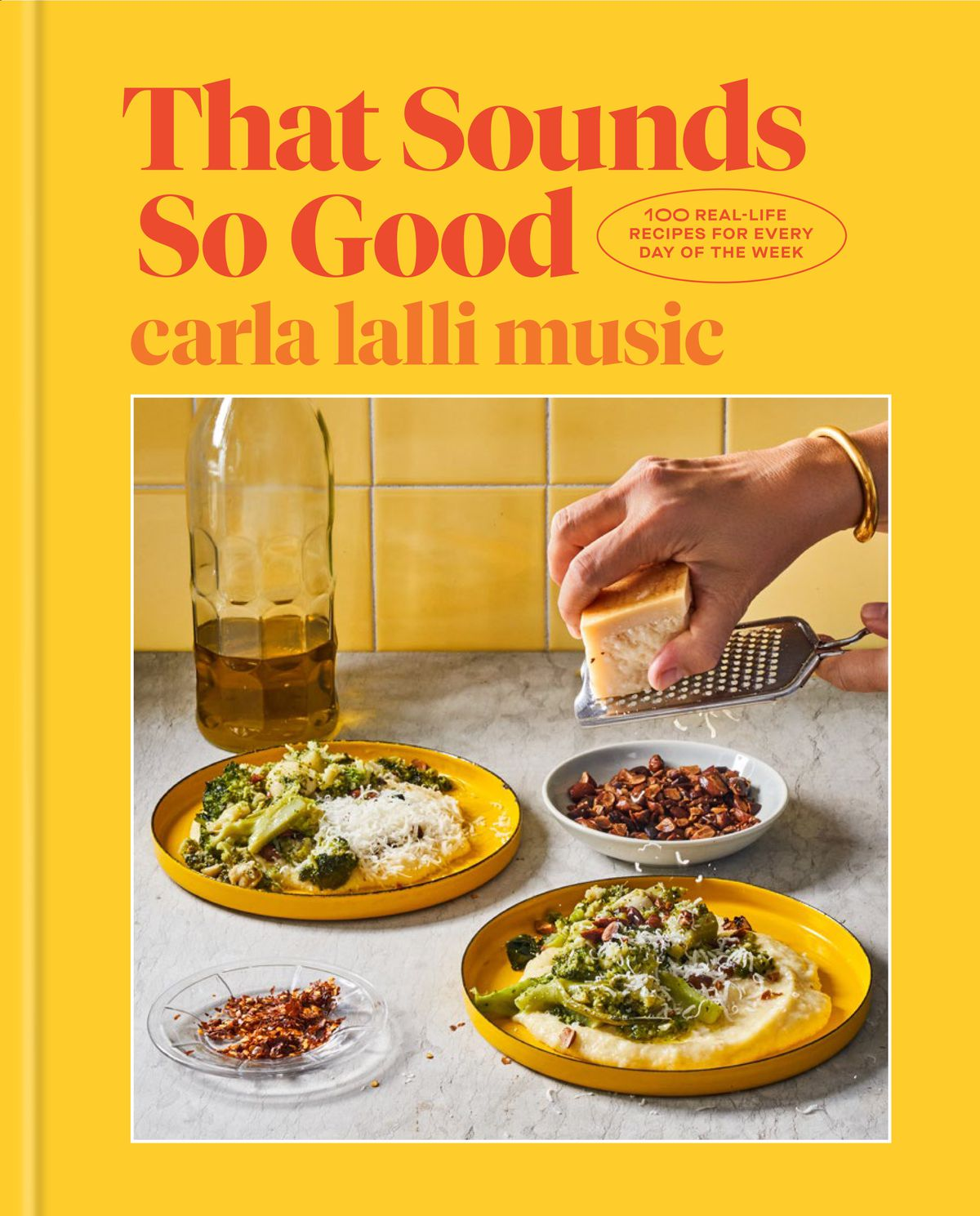 """A cookbook cover with an image of plates with food and a person grating cheese over them and the words """"That Sounds So Good carla lalli music"""""""