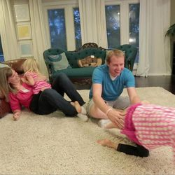 The Parker family plays together in their home. Alissa Parker says the year since losing her daughter Emilie in the Newtown school shootings has brought unimaginable grief but also personal growth and moments of joy.