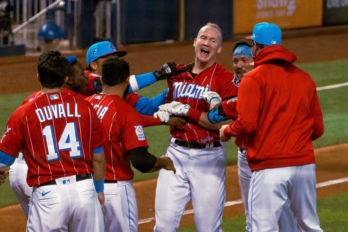 Garrett Cooper celebrates at home plate with his Marlins teammates after hitting a walk-off home run