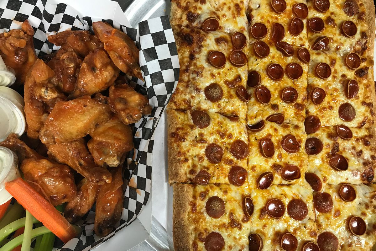 Chicken wings on the left and pizza on the right