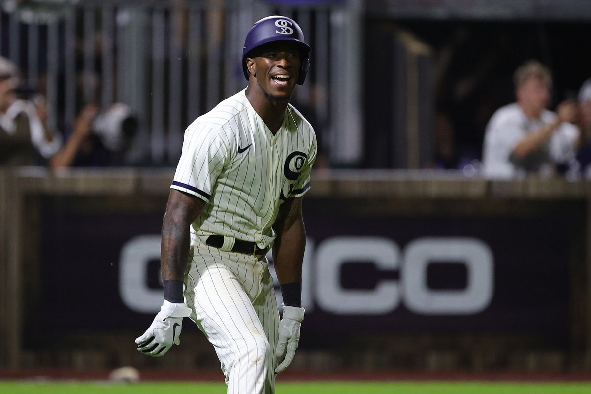 The White Sox' Tim Anderson celebrates a walk off two run home run during the ninth inning against the New York Yankees at the Field of Dreams game in Dyersville, Iowa.
