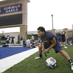 BYU running back Harvey Unga stretches during Wednesday's practice at Bishop Gorman High School in west Las Vegas.