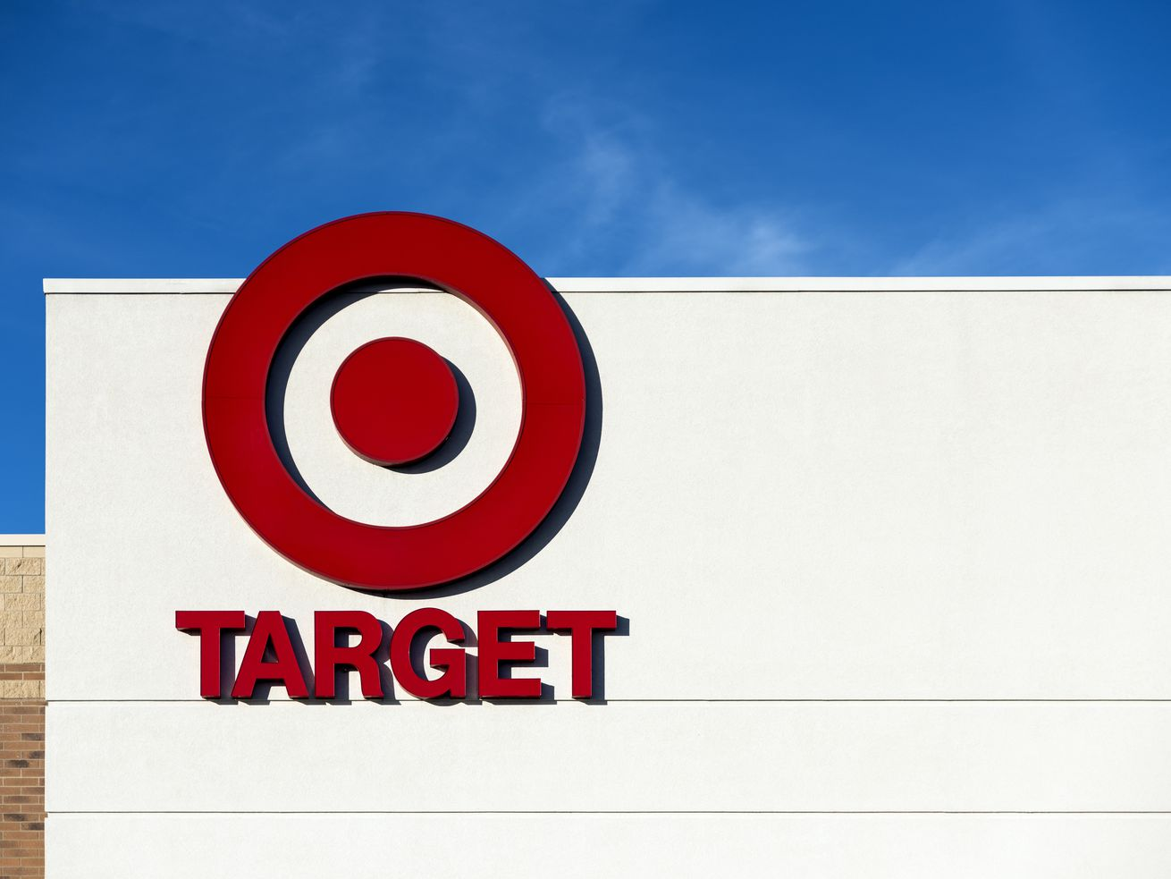 The Target bullseye logo on the front of a Target retail store.