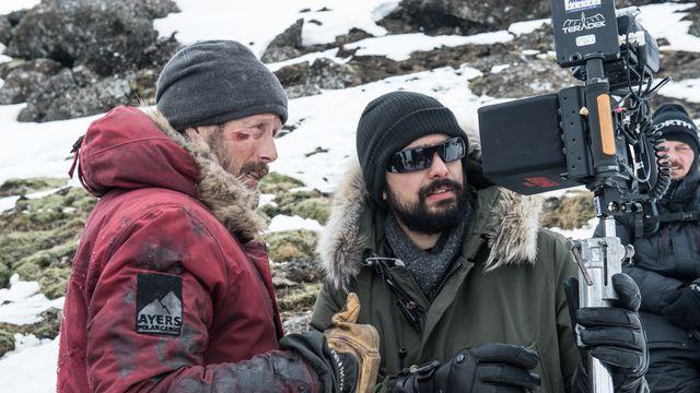 Mads Mikkelsen and director Joe Penna on the set of <em>Arctic.</em>