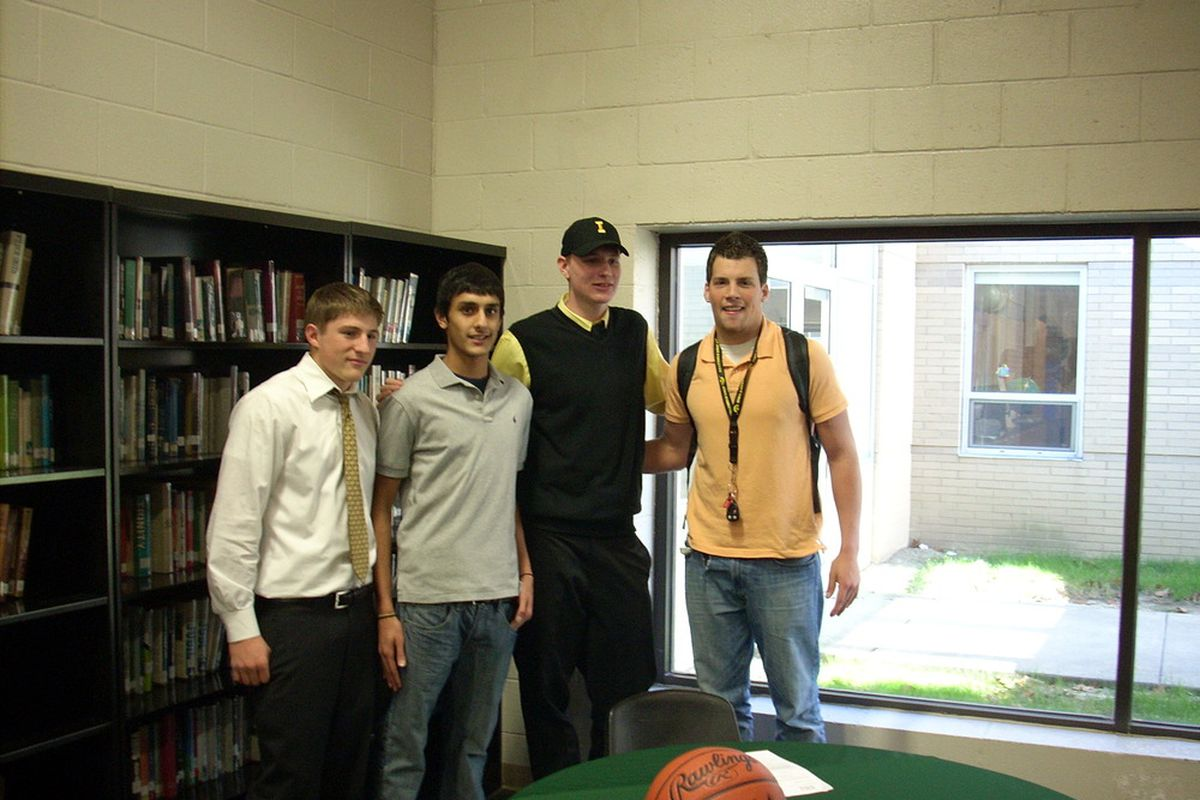 Mustangs forward Aaron White, third from left,  posses for photo's with teammates moments after signing on the dotted line to play for Iowa. Along side is friend, and future Iowa tight end Ray Hamilton.