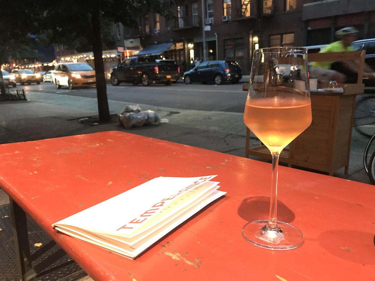 a glass of orange wine