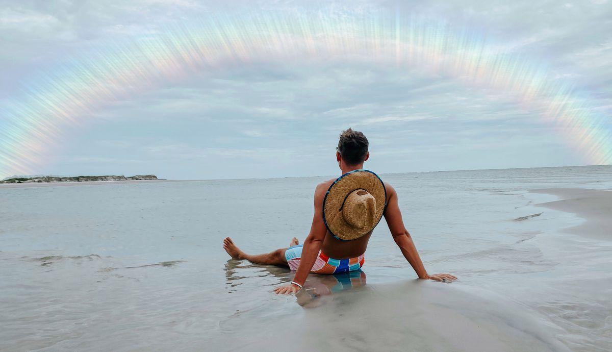 Matt Lynch sits on the beach.