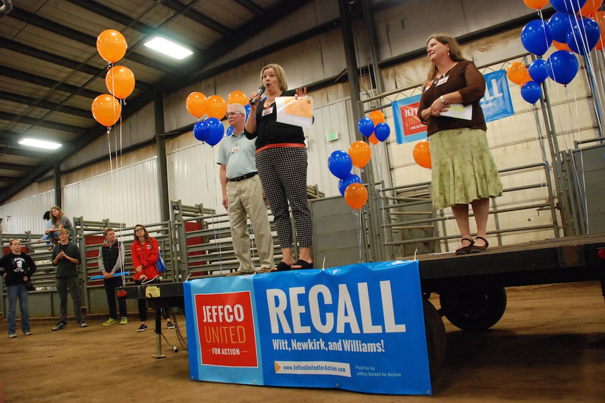 Organizers of a school board recall effort in Jefferson County, from left, Michael Blanton, Wendy McCord, and Tina Gurdikian, spoke at the campaign kick off event in July.