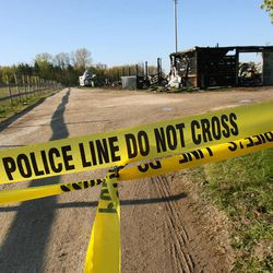 Police tape covers the entrance to Black Tie Stable Thursday morning April, 12, 2012 after a Wednesday evening fire destroyed the facility and killed 10 horses just West of Fox Lake in McHenry County, Ill.