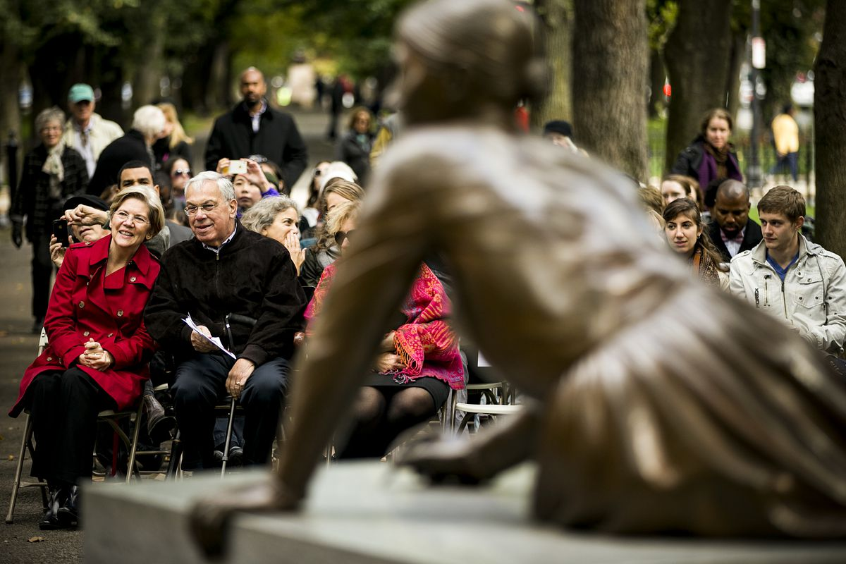 Senator Warren and Boston Mayor Tom Menino at the 10th Anniversary Celebration of the Boston Women's Memorial, in Boston, Massachusetts, on October 27, 2013; in the foreground is a statue of Lucy Stone, orator, abolitionist, suffragist and a vocal advocat