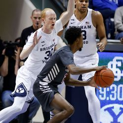Brigham Young Cougars guard TJ Haws (30) and Yoeli Childs (23) guard Santa Clara Broncos guard Tahj Eaddy (2) at Brigham Young University in Provo on Thursday, Feb. 20, 2020.