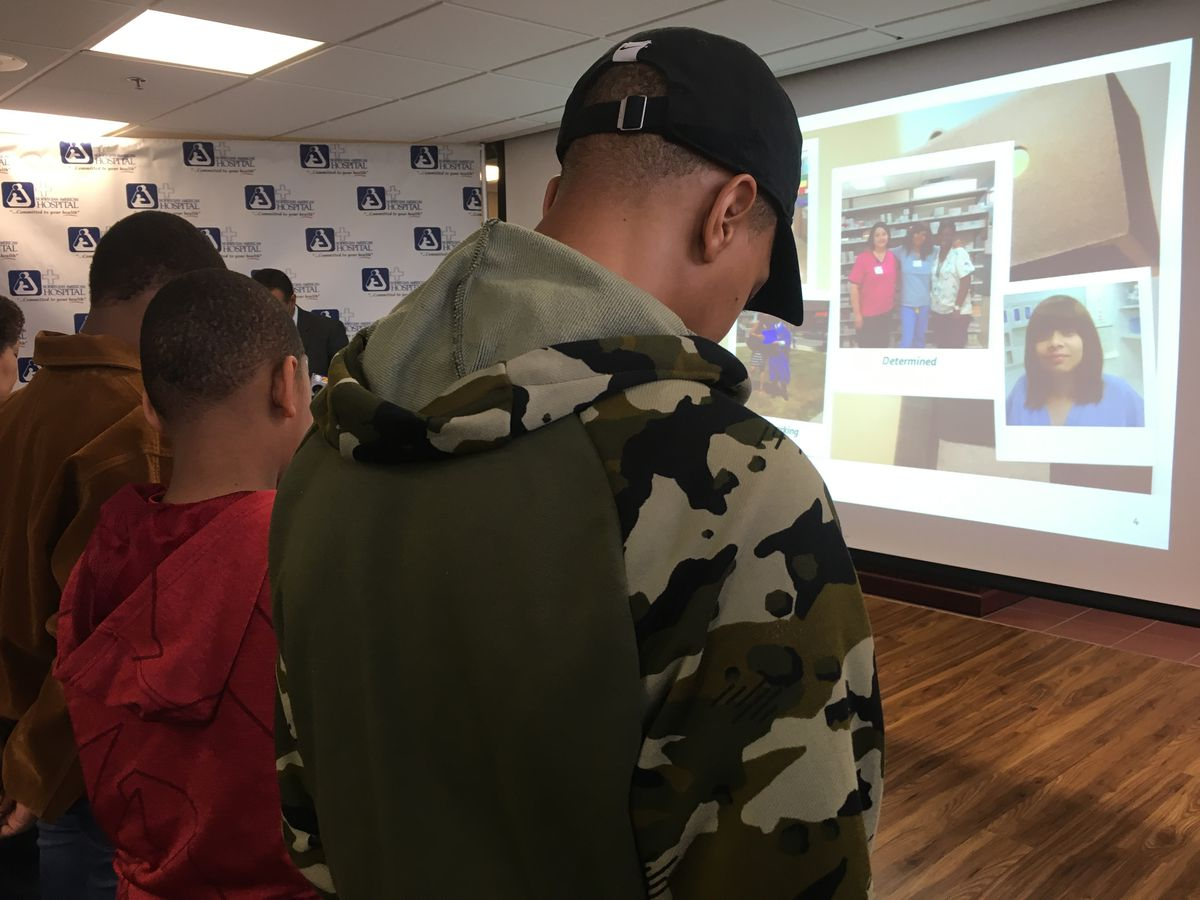 Candice Dickerson's three sons attended a ceremony honoring their mother at Norwegian American Hospital. Dickerson was a pharmacy technician at the hospital for 14 years; she was gunned down April 26 while shopping for a cell phone for one of her sons. |