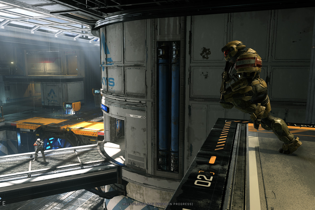 Screenshot of a multiplayer map in Halo Infinite: an armored futuristic soldier runs off a ramp to engage an opponent