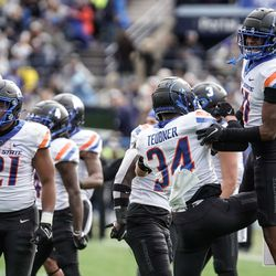Boise State players celebrate after a turnover against BYU during an NCAA college football game at LaVell Edwards Stadium in Provo on Saturday, Oct. 9, 2021.