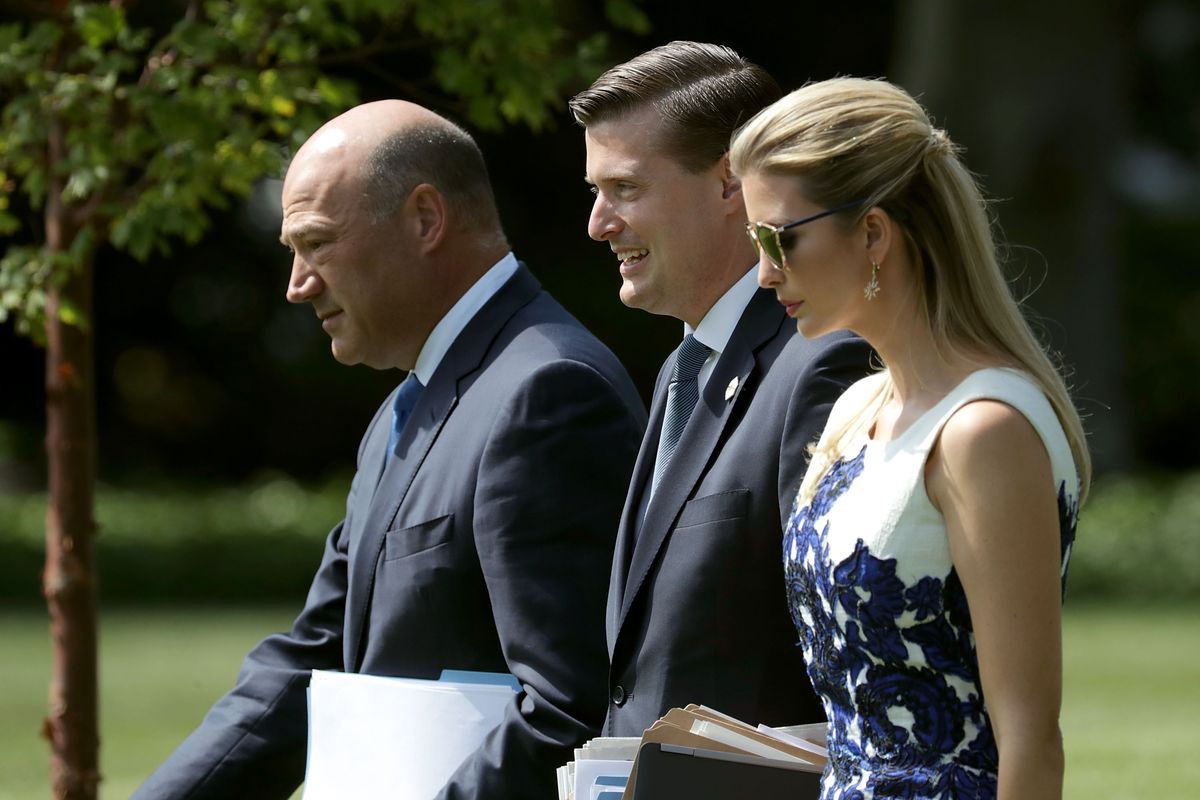 Rob Porter (center), the former White House staff secretary whom President Donald Trump reportedly wants to hire back, pictured here in August 2017