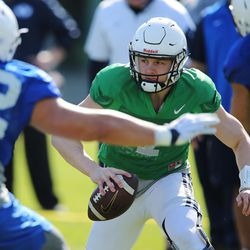 BYU quarterback Beau Hoge (7) runs during practice in Provo on Wednesday, March 8, 2017.