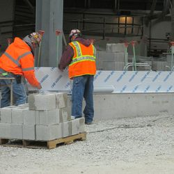 2:56 p.m. Covers being placed on the concrete blocks, along Waveland -