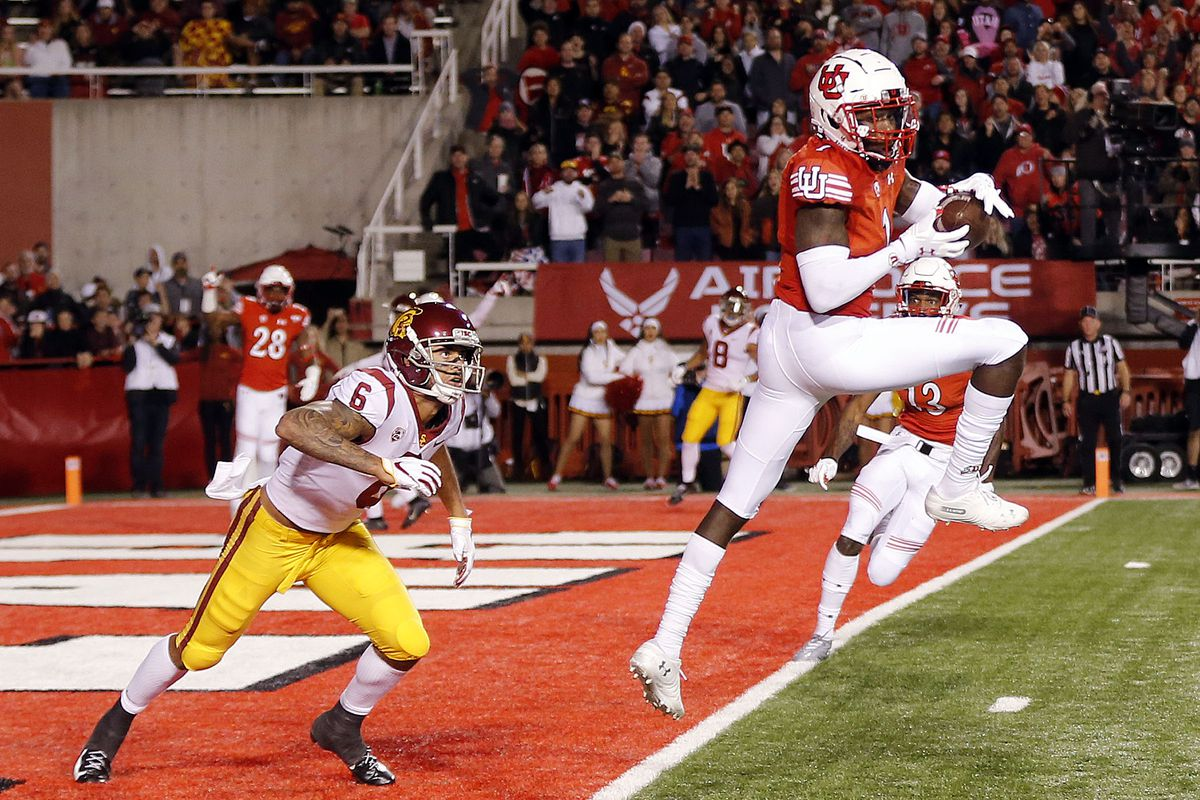 Utah Utes defensive back Jaylon Johnson catches an interception with USC Trojans wide receiver Michael Pittman Jr. at left during NCAA football in Salt Lake City on Saturday, Oct. 20, 2018.