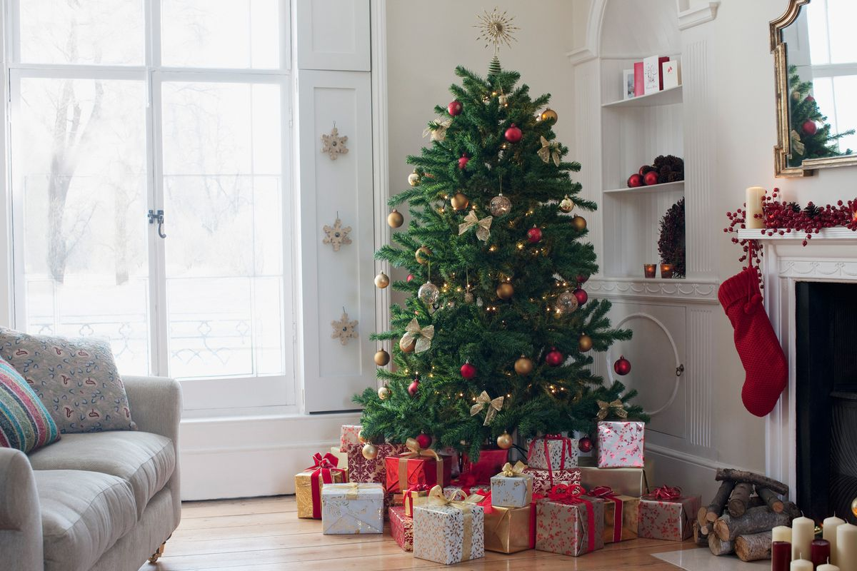 Christmas tree surrounded with gifts.